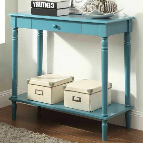 blue wooden console table behind sofa entry