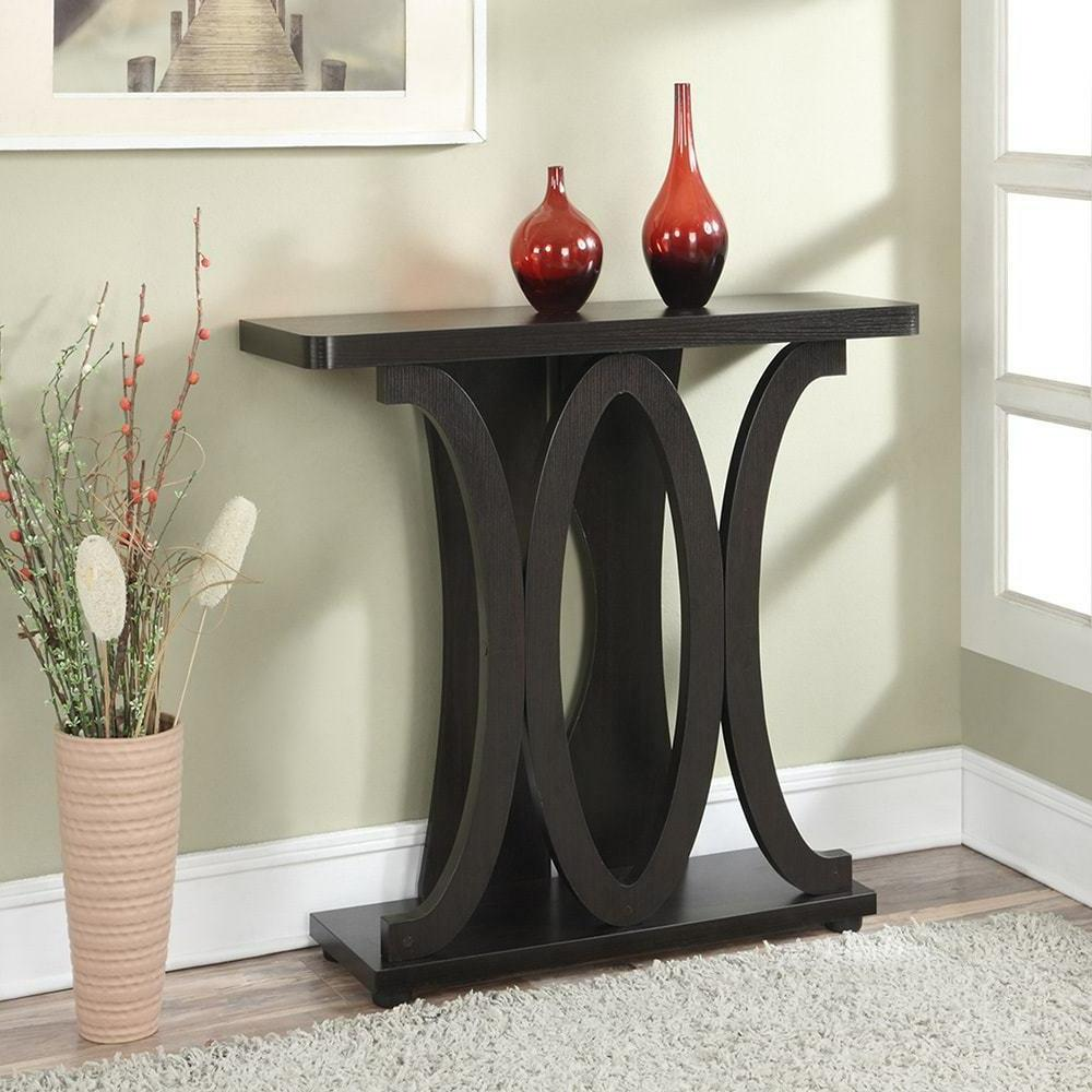 brown console entryway table with oval accents