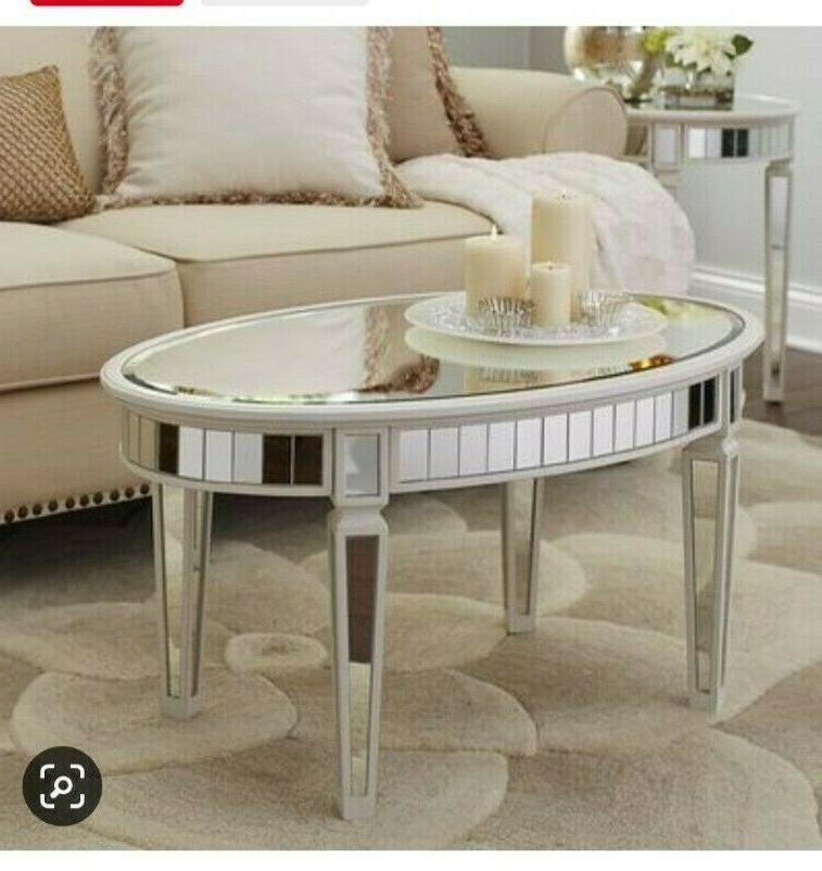 cream colored mirrored oval coffee table